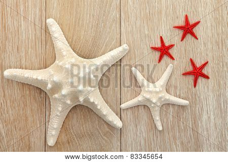 Starfish sea shell abstract over old oak background.