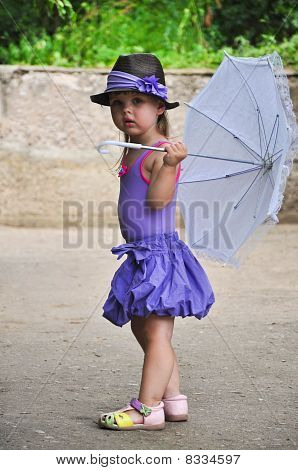 Little girl with sun umbrella