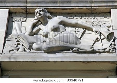 Sculpture Bas-relief On Technical Subject On The Building In The Center Of Lvov