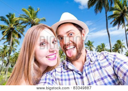 Beautiful Couple taking a selfie photo in the nature