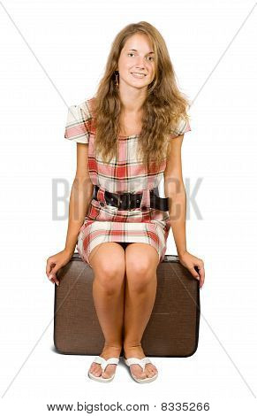 Girl Sitting On Suitcase