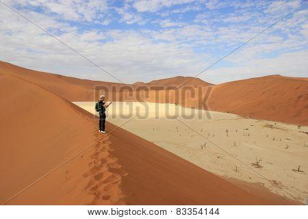 Tourist In The Sossusvlei Desert, Namibia