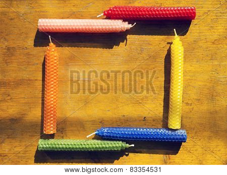 Frame of natural beeswax candles