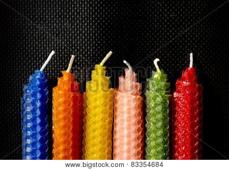 Natural beeswax candles on black