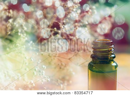 Essence bottle and colorful bokeh