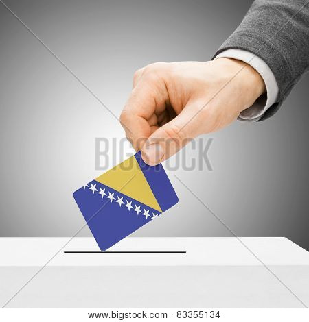 Voting Concept - Male Inserting Flag Into Ballot Box - Bosnia And Herzegovina