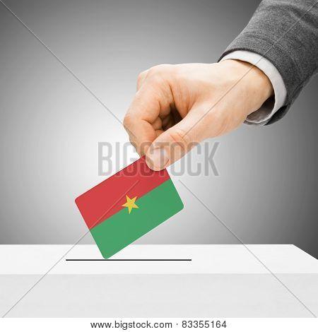 Voting Concept - Male Inserting Flag Into Ballot Box - Burkina Faso