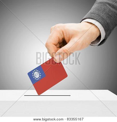 Voting Concept - Male Inserting Flag Into Ballot Box - Burma