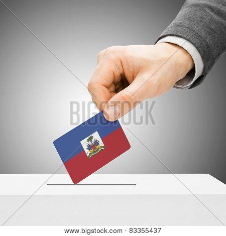 Voting Concept - Male Inserting Flag Into Ballot Box - Haiti