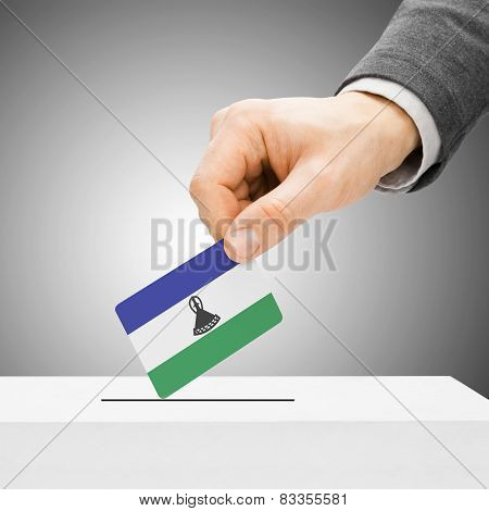 Voting Concept - Male Inserting Flag Into Ballot Box - Lesotho