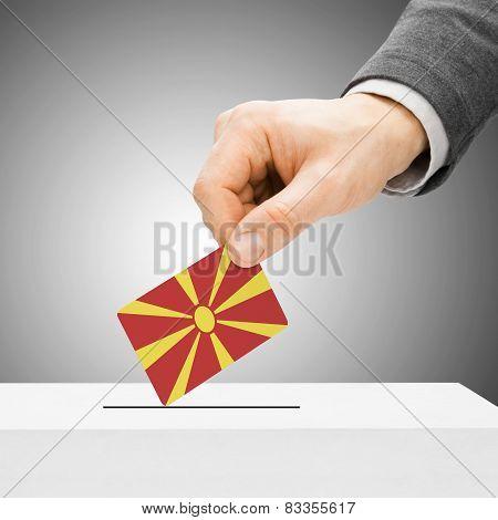 Voting Concept - Male Inserting Flag Into Ballot Box - Republic Of Macedonia