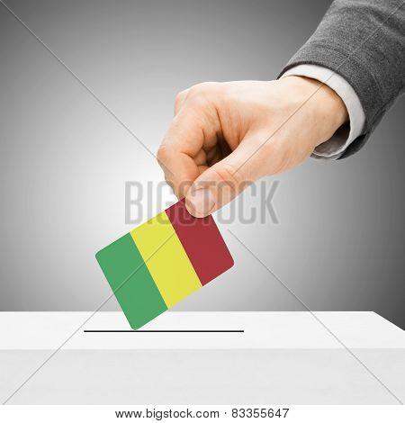 Voting Concept - Male Inserting Flag Into Ballot Box - Mali