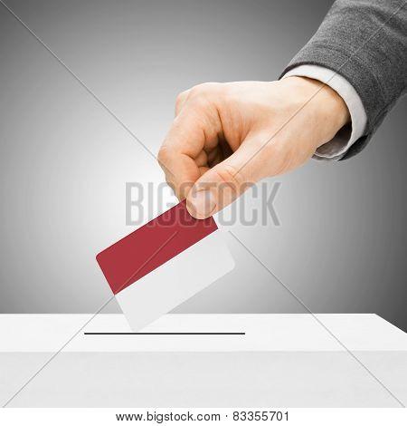 Voting Concept - Male Inserting Flag Into Ballot Box - Monaco