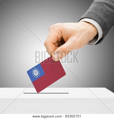 Voting Concept - Male Inserting Flag Into Ballot Box - Burma - Myanmar