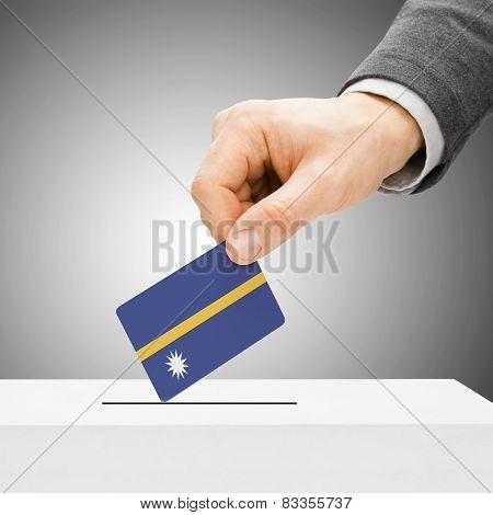 Voting Concept - Male Inserting Flag Into Ballot Box - Nauru