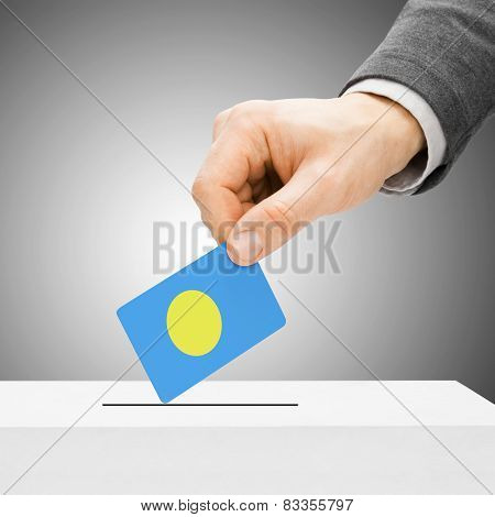 Voting Concept - Male Inserting Flag Into Ballot Box - Palau