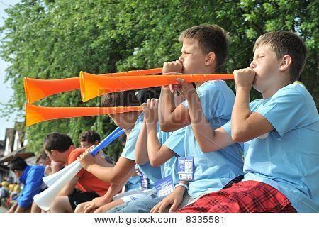 the children blow the vuvuzela