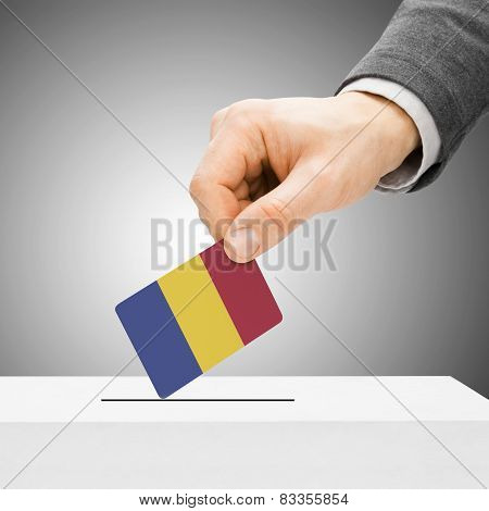 Voting Concept - Male Inserting Flag Into Ballot Box - Romania