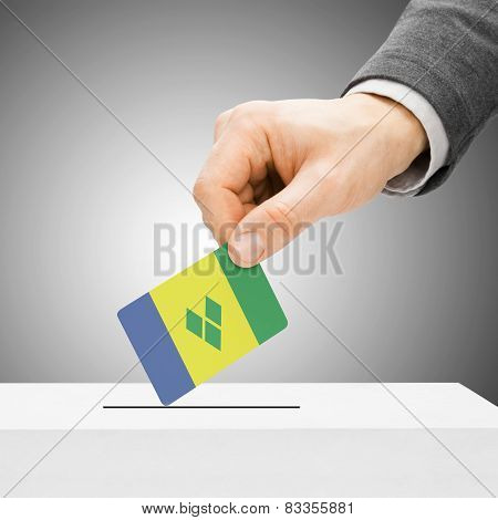 Voting Concept - Male Inserting Flag Into Ballot Box - Saint Vincent And The Grenadines