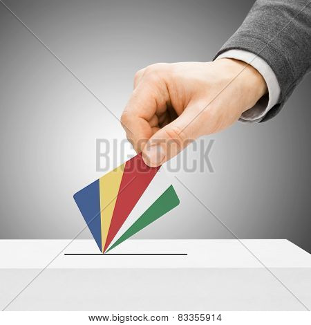 Voting Concept - Male Inserting Flag Into Ballot Box - Seychelles