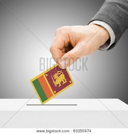 Voting Concept - Male Inserting Flag Into Ballot Box - Sri Lanka