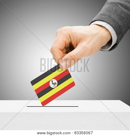 Voting Concept - Male Inserting Flag Into Ballot Box - Uganda