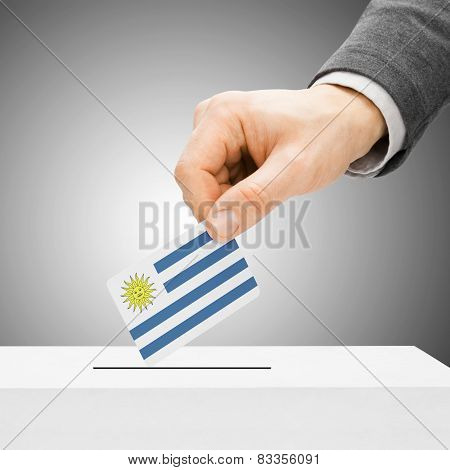 Voting Concept - Male Inserting Flag Into Ballot Box - Uruguay