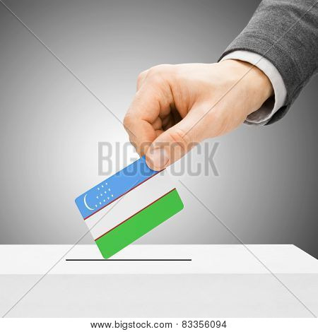 Voting Concept - Male Inserting Flag Into Ballot Box - Uzbekistan