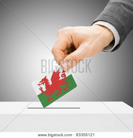 Voting Concept - Male Inserting Flag Into Ballot Box - Wales
