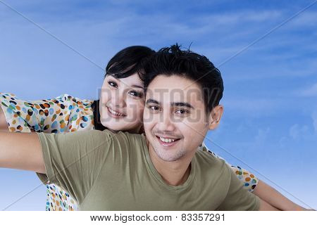 Asian Couple Having Fun On Blue Sky