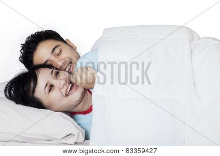 Couple Having Fun On Bedroom