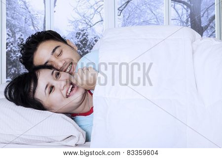 Couple Joking In Bedroom