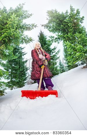 Girl working with shovel and cleaning snow