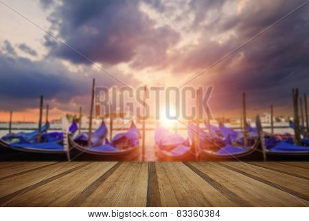 Gondolas Bobbing In Lagoon Outside San Marco Piazza Venice Italy With Sunburst With Wooden Planks Fl