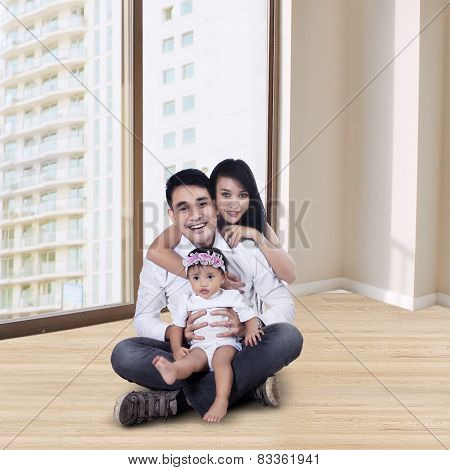 Happy Family On The New Apartment