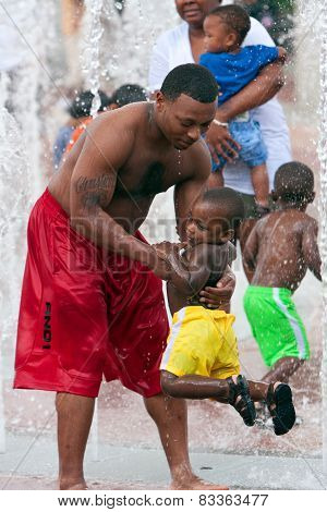Father Plays With Son In Fountain At Atlanta Park