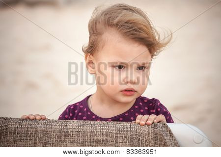 Outdoor Closeup Portrait Of Cute Serious Baby Girl