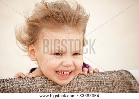 Caucasian Blond Baby Girl With Wind In Her Hair