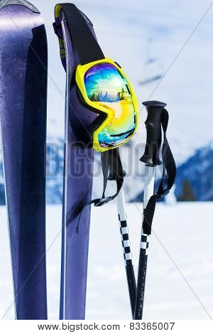 Mountain ski equipment close-up with mask and pole