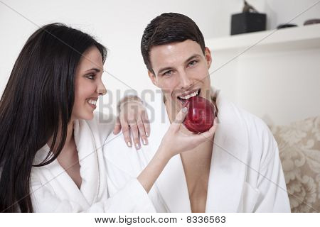 Happy couple with fruit