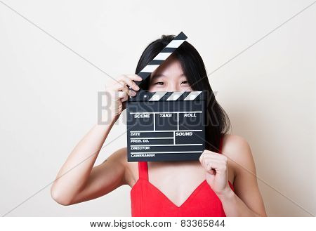 Young Beautiful Asian Woman Red Dress Smiling Eyes With Clapperboard