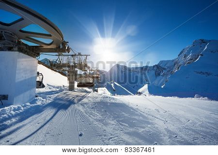 Ski lift near ski-track of Caucasus mountains