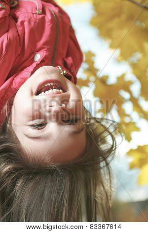upside down girl in autumn background