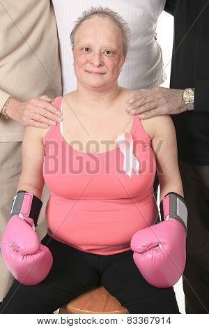 A woman holding a breast cancer logo