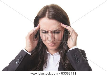 Businesswoman with a headache holding head, isolated on white ba