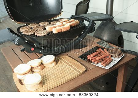 A BBQ with Hamburger, Bread and hot dog