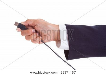 Hand holding USB cable