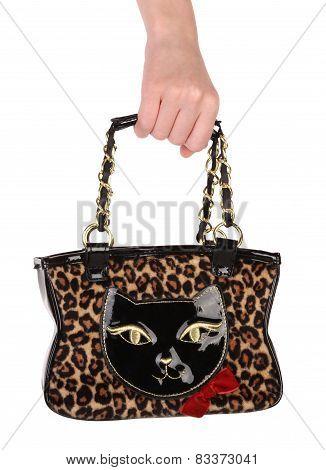 Hand Holding Leopard Handbag