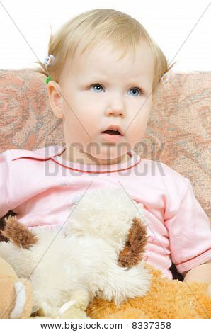 Cute Little Girl Sitting On Chair