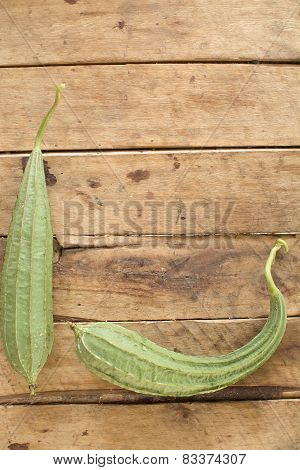 Gourds On Wood Background